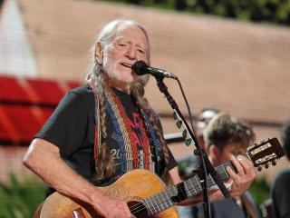 Willie Nelson & Family on stage at Walnut Creek Amphitheater in Raleigh. The annual Farm Aid benefit concert makes a stop in North Carolina on Sept. 13, 2014. (Chris Baird / WRAL Contributor).