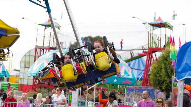 Hanna and Ethan McMinn, of Apex, ride the gliders. Photographer: Carlton Bassett