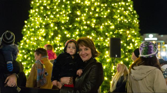 Sharon Baldwin and her grandson, Jackson, pose in front of the tree. Photos by: Carlton Bassett