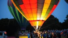 IMAGES: Balloons glow, tether in Raleigh