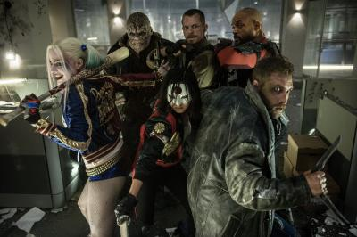 "Margot Robbie as Harley Quinn, clockwise from left, Adewale Akinnuoye-Agbaje as Killer Croc, Joel Kinnaman as Rick Flagg, Will Smith as Deadshot, Jai Courtney as Captain Boomerang and Karen Fukuhara as Kitana in Warner Bros. Pictures' ""Suicide Squad."" (Deseret Photo)"