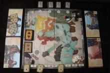 This is a look at the setup for a four-player game. A map of the ancient world along with several stacks of cards are displayed. Player boards representing different apostles surround the board. The books of the New Testament are located at the bottom of the board. (Deseret Photo)