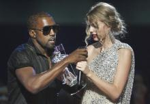 "In this Sept. 13, 2009 file photo, singer Kanye West takes the microphone from singer Taylor Swift as she accepts the ""Best Female Video"" award during the MTV Video Music Awards in New York. (Deseret Photo)"