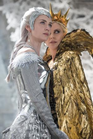 """Queen Freya (Emily Blunt) and Queen Ravenna (Charlize Theron) in the story that came before Snow White: """"The Huntsman: Winter's War."""" (Deseret Photo)"""