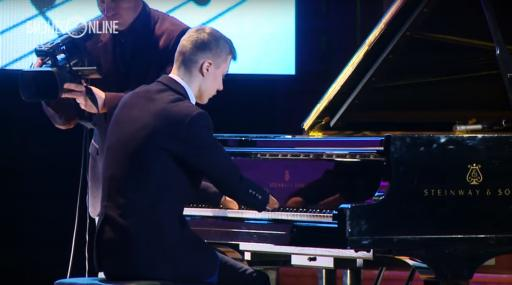 This inspiring young man has no hands, yet plays a moving piece on the piano and proves he's not just a novelty act, but a fabulous pianist. (Deseret Photo)