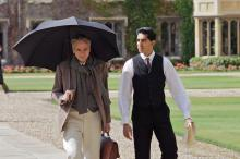 "G.H. Hardy (Jeremy Irons) and S. Ramanujan (Dev Patel) walk through the quad at Trinity College, Cambridge, in ""The Man Who Knew Infinity."" (Deseret Photo)"