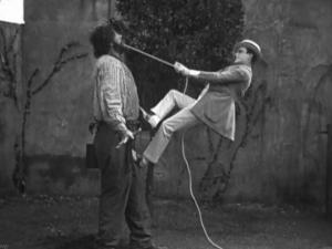 "Harold Lloyd tries the hard way to extract an aching tooth from his giant cellmate  (John Aasen) in ""Why Worry?"" (1923), one of Lloyd's best examples of clever slapstick comedy. (Deseret Photo)"
