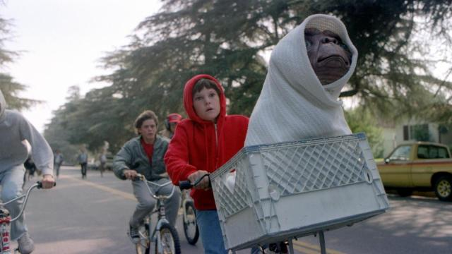 "Elliott (Henry Thomas) and his friends ride as fast as they can to get E.T. back to the forest in ""E.T. the Extra-Terrestrial."" (Deseret Photo)"