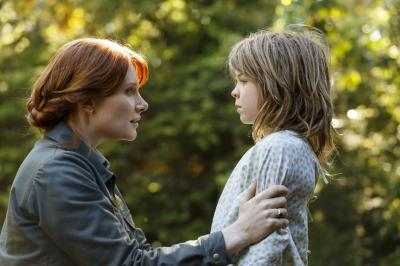 "Bryce Dallas Howard is Grace and Oakes Fegley is Pete in Disney's ""Pete's Dragon,"" the adventure of an orphaned boy and his best friend Elliot, who just so happens to be a dragon. (Deseret Photo)"