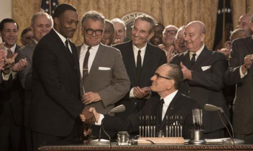 "Martin Luther King Jr. (Anthony Mackie) and President Lyndon Johnson (Bryan Cranston) shake hands as others observe in the HBO movie ""All the Way,"" now on Blu-ray and DVD. (Deseret Photo)"