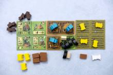 A player's farm might look like this near the end of the game. On the left are improvement tiles and in the middle are tiles representing the farmhouse. A bunch of pigs are in a field outside the house. On the right are four fields full of grain ready for harvest. (Deseret Photo)
