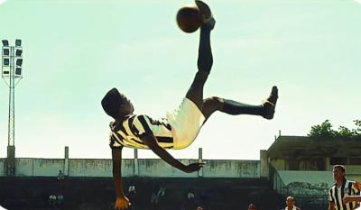"Kevin de Paula convincingly replicates a kick by soccer star Pelé in the biographical film ""Pelé: Birth of a Legend,"" now on DVD. (Deseret Photo)"