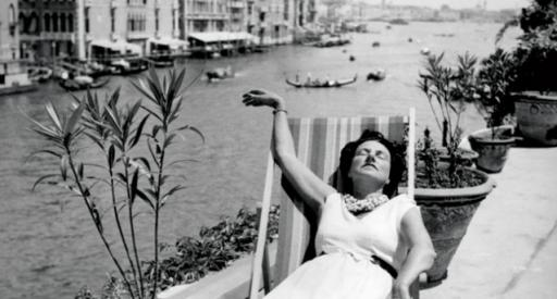 "Art patron and collector Peggy Guggenheim lounges at her Venice, Italy, home in the new documentary ""Peggy Guggenheim: Art Addict,"" now on DVD. (Deseret Photo)"