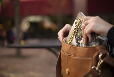 The new pocket edition of the Pathfinder RPG Bestiary fits nicely into a woman's purse. Transportation to game night is inconspicuous and seamless. (Deseret Photo)