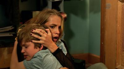 "Gabriel Bateman, left, as Martin and Teresa Palmer as Rebecca in ""Lights Out."" (Deseret Photo)"