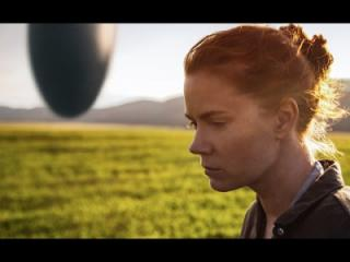 "Amy Adams plays a linguist attempting to communicate with aliens in a spaceship (shown in the distance to her left) in the new film ""Arrival,"" which poses interesting questions about language and communication. (Deseret Photo)"
