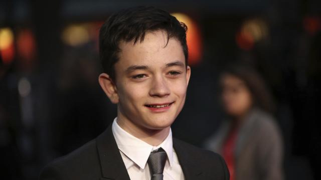 """Actor Lewis MacDougall poses for photographers upon arrival at the premiere of the film """"A Monster Calls"""" during the London Film Festival. (Deseret Photo)"""