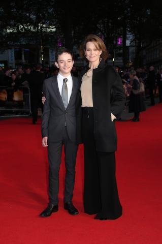 """Actors Lewis MacDougall and Sigourney Weaver poses for photographers upon arrival at the premiere of the film """"A Monster Calls,"""" during the London Film Festival. (Deseret Photo)"""
