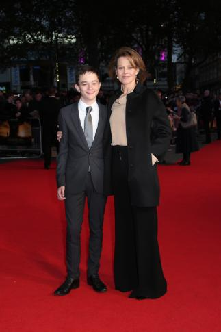 "Actors Lewis MacDougall and Sigourney Weaver poses for photographers upon arrival at the premiere of the film ""A Monster Calls,"" during the London Film Festival. (Deseret Photo)"