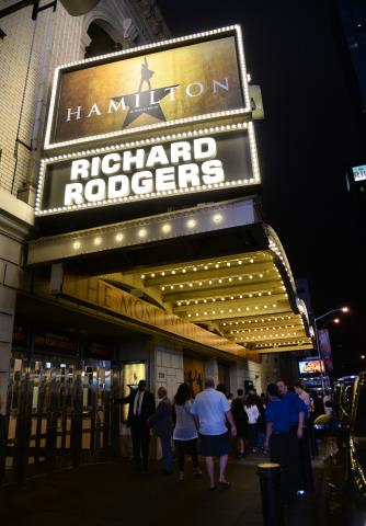 "People gather outside the ""Hamilton"" marquee at the Richard Rogers Theatre on Saturday, July 9 in New York City (Deseret Photo)"