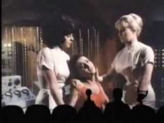 """Snug in their theater seats (at the bottom of the photo), the snarky """"MST3K"""" team mocks the acknowledged lousy sci-fi thriller """"The Human Duplicators"""" in the new DVD set """"Mystery Science Theater 3000: XXXVII."""" (Deseret Photo)"""