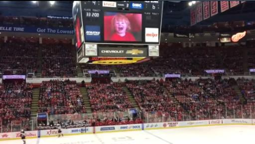 Who cares about watching a hockey game when this kid is on the jumbotron? (Deseret Photo)