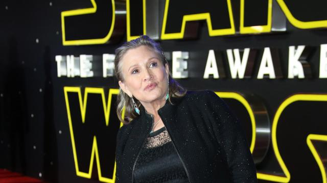 "Carrie Fisher poses for photographers after arriving at the European premiere of the film ""Star Wars: The Force Awakens"" in London, Wednesday, Dec. 16, 2015. (Deseret Photo)"