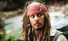 """Johnny Depp plays the very cartoony Capt. Jack Sparrow in the """"Pirates of the Caribbean"""" films. Depp is featured in the only live-action clip with dozens of animated scenes displayed on the Disneyland California Adventure Park's """"World of Color"""" water show. (Deseret Photo)"""
