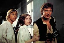 """Mark Hamill as Luke Skywalker, Carrie Fisher as Princess Leia and Harrison Ford as Han Solo escape from the Death Star in """"Star Wars: Episode IV A New Hope."""" (Deseret Photo)"""