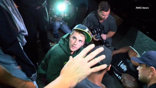 Singer Justin Bieber struck a paparazzo with his truck while trying to drive away from an event in Beverly Hills Wednesday July 27, 2017 night, according to the Beverly Hills Police Department.