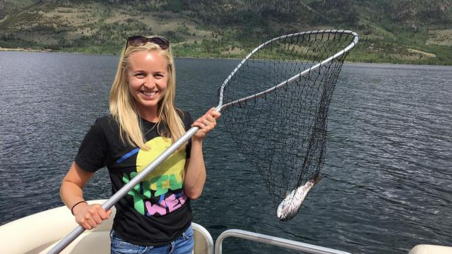 Carmen Rasmusen Herbert shows off a fish and a makeup-free face at Fish Lake. (Deseret Photo)