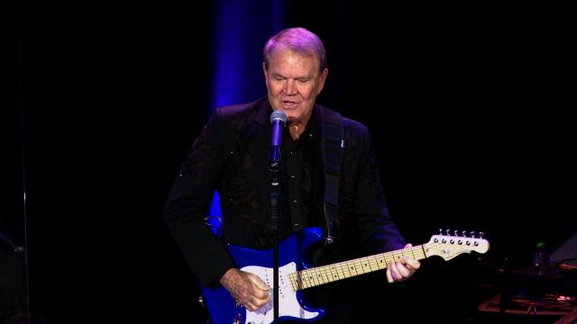 Iconic country music singer and guitarist Glen Campbell passed away at age 81 on August 8, 2017. He is seen here performing in 2015.