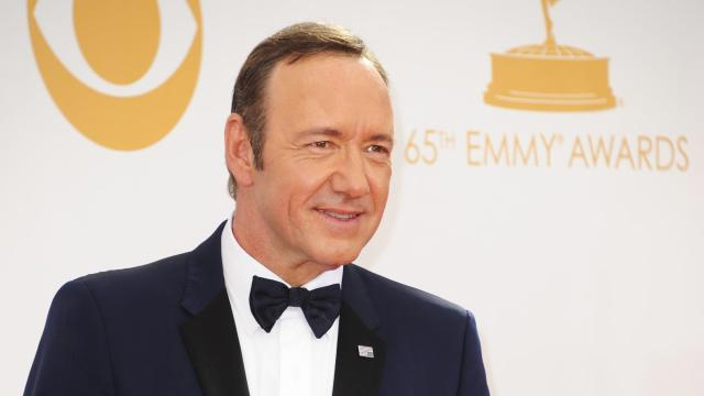 Actor Kevin Spacey poses on the red carpet before attending the 65th Annual Primetime Emmy Awards in Los Angeles, California on September 22, 2013.