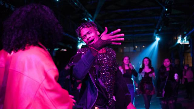 Fans dancing at the Knockdown Center, where Cardi B was the main attraction, in New York's Queens borough, Dec. 31, 2017. Single and restless on a frigid New Year's Eve, New York Times writer Isaac Oliver set out on a citywide culture crawl. (Joel Barhamand/The New York Times)
