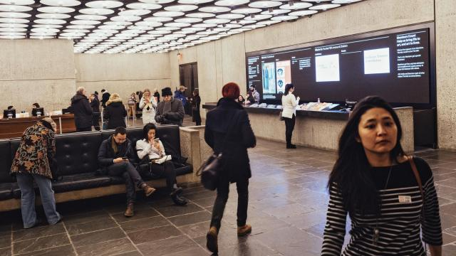 Visitors in the lobby area of the Metropolitan Museum of Art's Breuer building, in New York, Jan. 3, 2018. A new admissions policy announced by the Met -- visitors who do not live in the state must pay a mandatory admission of $25 beginning March 1, 2018 -- will allow three-day access to all three Met locations. (Andrew White/The New York Times)