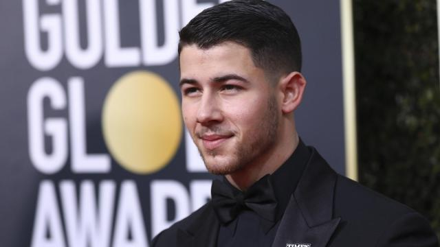 Nick Jonas wearing a Time's Up pin on the red carpet prior to the 75th Golden Globe Awards in Beverly Hills, Calif., Jan. 7, 2018. (Damon Winter/The New York Times)