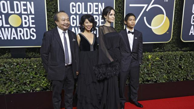 From left: Cambodian film producer Rithy Panh, Cambodian-born activist and author Loung Ung, Angelina Jolie and her son Pax on the red carpet prior to the 75th Golden Globe Awards in Beverly Hills, Calif., Jan. 7, 2018. (Damon Winter/The New York Times)