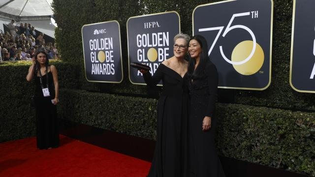 Meryl Streep, left, and Ai-Jen Poo, the director of the National Domestic Workers Alliance on the red carpet prior to the 75th Golden Globe Awards in Beverly Hills, Calif., Jan. 7, 2018. As the women behind Time's Up campaign to combat sexual harassment figure out if they can sustain the momentum from the Golden Globes, the Academy Awards face the specter of uncomfortable male moments. (Damon Winter/The New York Times)
