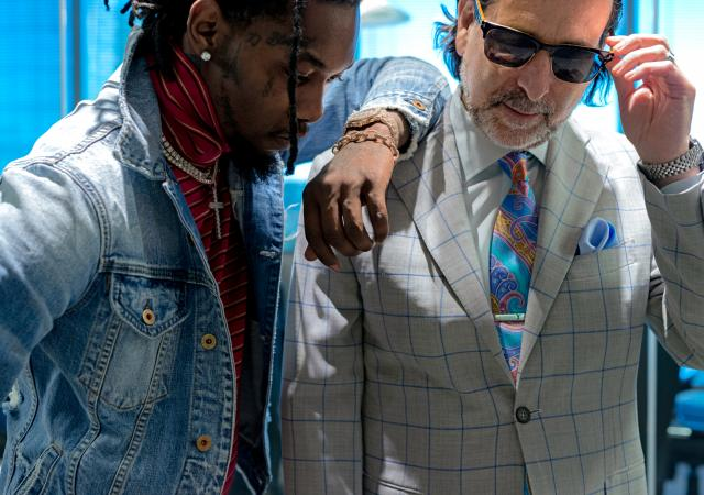"""Drew Findling, an attorney and indispensable behind-the-scenes fixture in the hip-hop world, with the rapper Offset at his office in Atlanta, Jan. 9, 2018. Findling has taken on the role of a mentor, and even a father figure, to many rappers. """"It is increasingly disturbing to me, the 'X' that is on the forehead of people in this industry,"""" he said. (Johnathon Kelso/The New York Times)"""