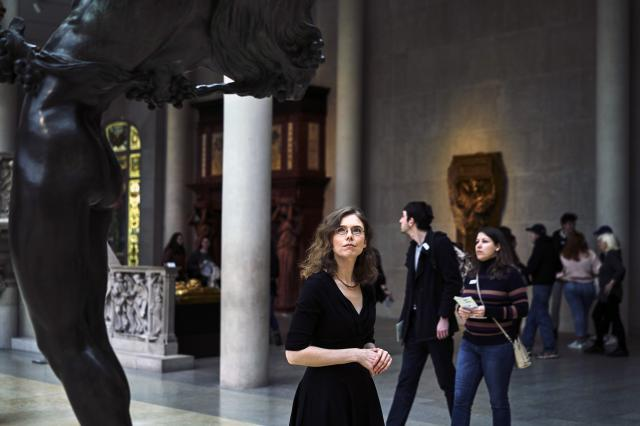 """Madeline Miller in the Greek and Roman galleries at the Metropolitan Museum of Art in New York, March 13, 2018. Her new novel, """"Circe,"""" is a bold and subversive retelling of the goddess Circe's story that manages to be both epic and intimate in its scope, recasting the most infamous female figure from the Odyssey as a hero in her own right. (An Rong Xu for The New York Times)"""