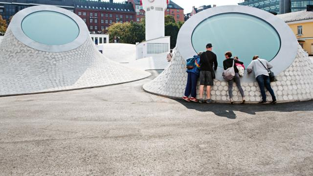 A group takes a look inside the Amos Rex museum in Helsinki, Finland Aug. 29, 2018. The $58 millionprivately funded museum arrived less than two years after Helsinki's City Councilrejected a planto build a $138 million Guggenheim museum along the city's harbor. (Vesa Laitinen/The New York Times)