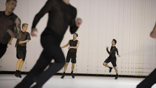 """The North American premiere of Anne Teresa De Keersmaeker's dance piece """"The Six Brandenburg Concertos,"""" at the Park Avenue Armory in New York, Sept. 30, 2018. The Belgian choreographer had performers crossing the vast Armory stage in circles, straight lines and spirals. (Julieta Cervantes/The New York Times)"""