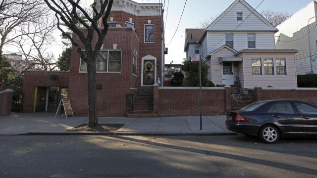 FILE-- The Louis Armstrong House Museum, left, and the house that Selma Heraldo lived in for 88 years, right, in Queens, New York, Dec. 14, 2011. The New York City Department of Cultural Affairs and the Louis Armstrong House Museum have announced in 2018 that the city has allocated $1.9 million to help renovate the two-story home known as Selma's House, the old home of the Armstrongs' longtime neighbor Selma Heraldo. (Marilynn K. Yee/The New York Times)