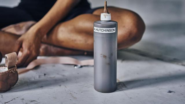 Alexandra Hutchinson paints her point shoes with makeup to match her skin tone, at the Dance Theater of Harlem in New York, Oct. 31, 2018. In October, Freed of London started selling two point shoes specifically for dancers of color: One brown, the other bronze. The new shoes highlight one of the stranger rituals that dancers of color have to perform. (An Rong Xu/The New York Times)