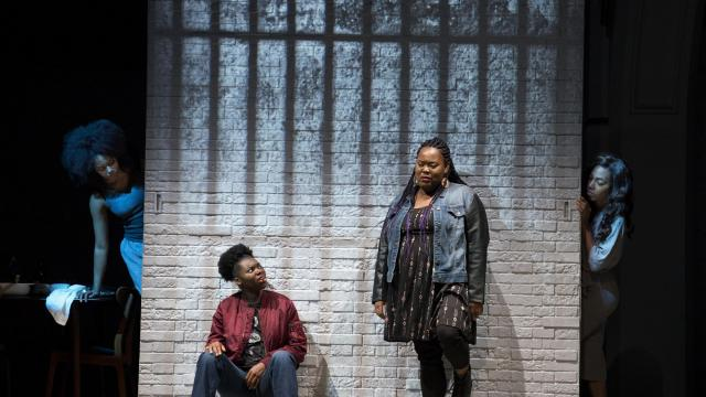 """Kadijah Raquel, center left, and Ashley D. Kelley in the play """"Eve's Song"""" at the Public Theater in Manhattan, Oct. 20, 2018. Patricia Ione Lloyd's macabre domestic comedy suggests that for African-Americans, every day is a potential horror movie in the making. (Sara Krulwich/The New York Times)"""