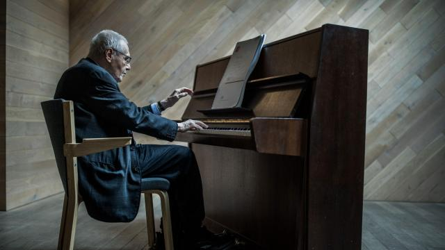"""Gyorgy Kurtag, the Hungarian composer, in an attic studio at the Budapest Music Center in Budapest, Oct. 11, 2018. At 92, one of the last living giants of 20th-century music has just completed his first opera, based on Samuel Beckett's """"Endgame."""" (Akos Stiller/The New York Times)"""