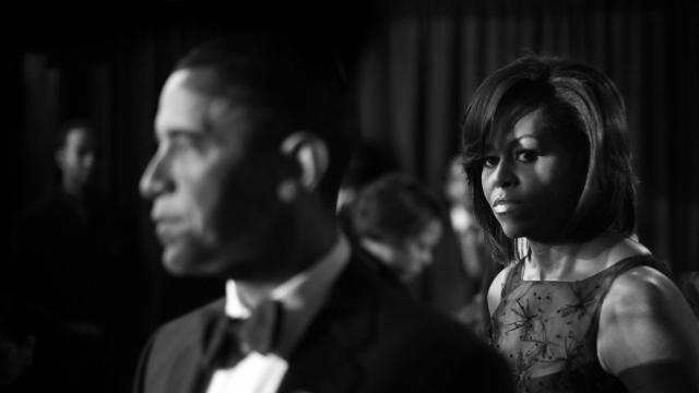 """FILE -- Then-first lady Michelle Obama, right, and then-President Barack Obama, backstage at the Congressional Black Caucus Dinner in Washington, Sept. 26, 2009. In """"Becoming,"""" her highly-anticipated memoir, Michelle talked about suffering a miscarriage, relying on IVF to conceive and the challenges of being the first African-American first lady. (Damon Winter/The New York Times)"""