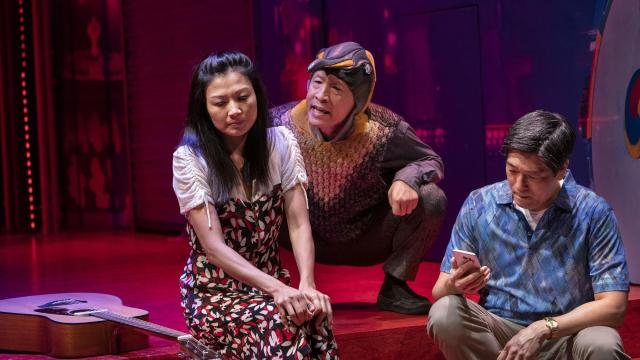 """From left: Michelle Krusiec, Francis Jue and Peter Kim in the play """"Wild Goose Dreams"""" at the Public Theater in New York, Oct. 30, 2018. Hansol Jung's industriously imaginative play uses visions of winged flight to explore the loneliness of two ambivalent lovers in Seoul. (Sara Krulwich/The New York Times)"""