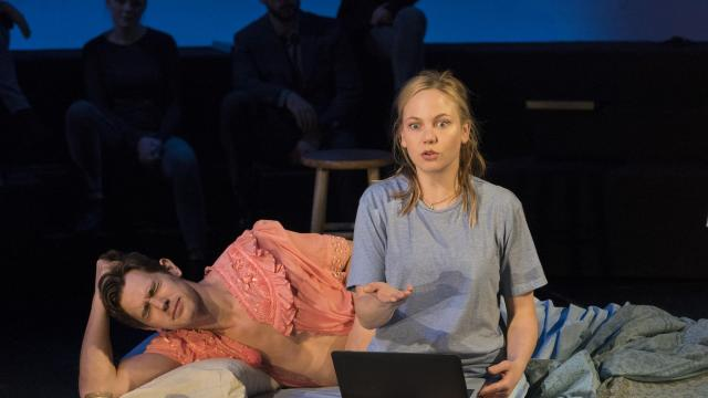 """Chris O'Shea and Adelaide Clemens in the play """"The Hard Problem"""" at the Mitzi E. Newhouse Theater in New York, Oct. 24, 2018. In this garrulous play of ideas, the author of """"The Real Thing"""" and """"The Coast of Utopia"""" takes on the essence — and ethics — of being human. (Sara Krulwich/The New York Times)"""