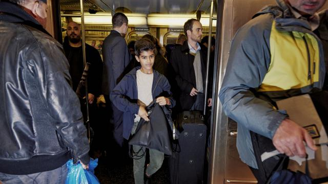 """-- PHOTO MOVED IN ADVANCE AND NOT FOR USE - ONLINE OR IN PRINT - BEFORE NOV. 25, 2018. -- Tenzin Niles, one of the young stars of the New York City Ballet production of """"The Nutcracker,"""" takes the subway to a rehearsal in Manhattan, Nov. 6, 2018. Some 126 students, ages 8 to 12, from the City Ballet-affiliated School of American Ballet are participating in this year's """"Nutcracker,"""" led by the two very different 11-year-olds alternating in the part of the Prince. (Vincent Tullo/The New York Times)"""